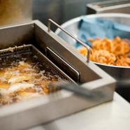 Onion bhaji frying