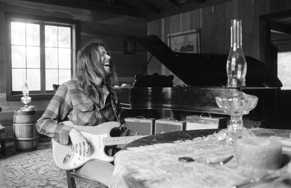 Neil Young laughing at his home during a publicity photo shoot with Henry Diltz in 1971.