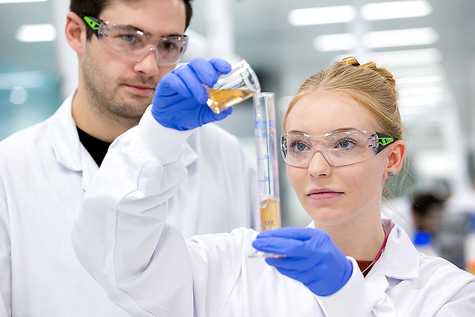 Laboratory research scientists conducting experiments at Reckitt Benckiser health care, Hull, East Yorkshire.