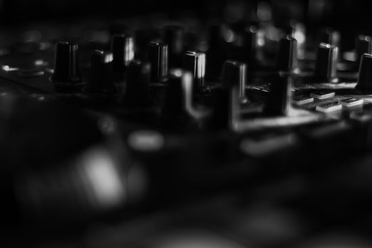 Blurred DJ turn table with lots of knobs