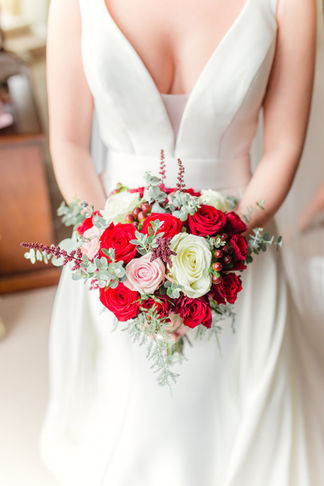 Bride holding bouquet, Tiltsone House, Cheshire