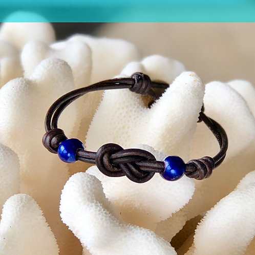 Double Infiniti Knot with Blue Pearls Bracelet