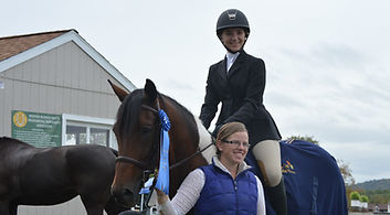 Deanna Pratt with student, Amber, after her win in the Finnegan Equitation Challenge at Willow Hill Farm's Fall Classic