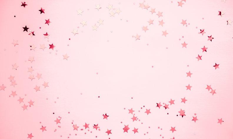 Festive pink background. Shining stars o