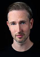 Headshot-portrait-on-black-backgorund