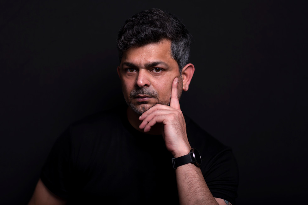 Male-actor-headshot-on-black-background