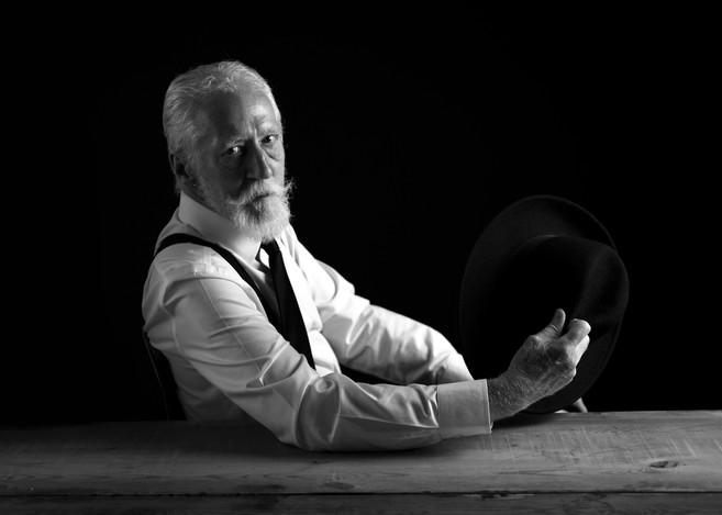 Male-model-portrait-photo-holding-hat