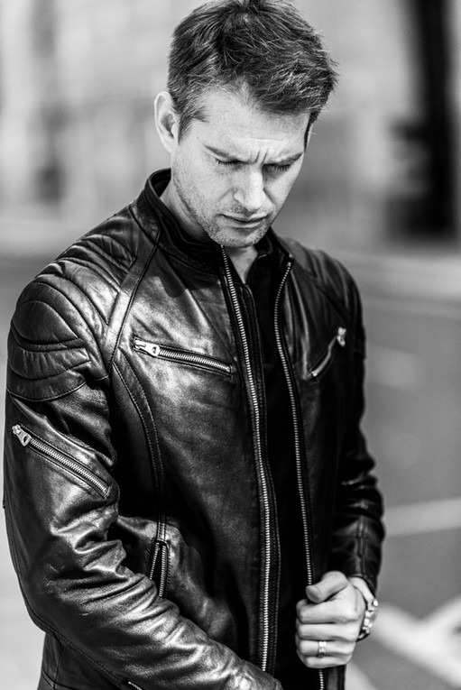 Male-model-photographed-outdoors-with-a-leather-jacket