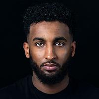 Male-model-headshot-portrait-on-black-background