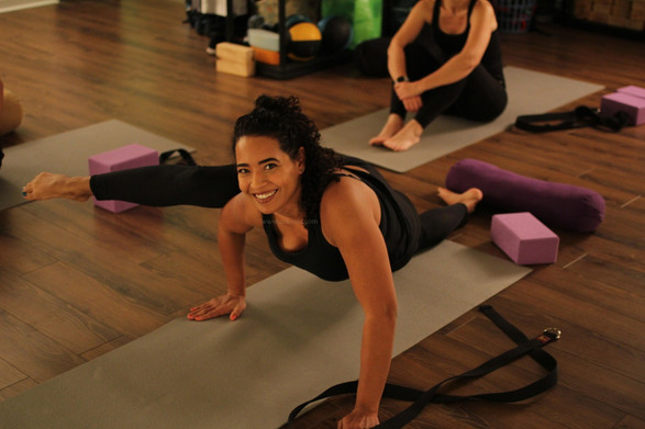 smiling fitness model yoga pose