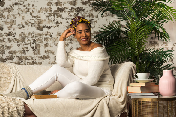 African headwrap model relaxing couch