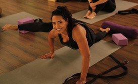 smiling fitness model yoga pose