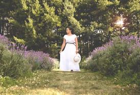 lifestyle model holding white dress