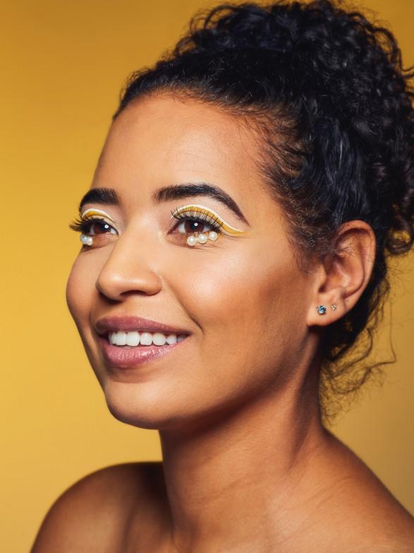 beauty model golden backdrop