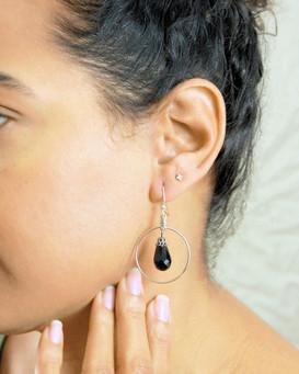 black drop earrings on parts model