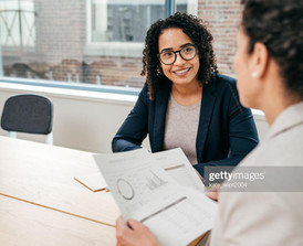 business woman smiling at coworker