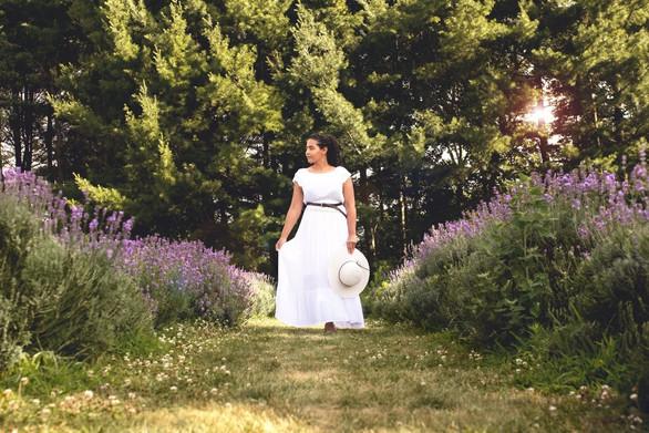 model in white flowing dress lavender field