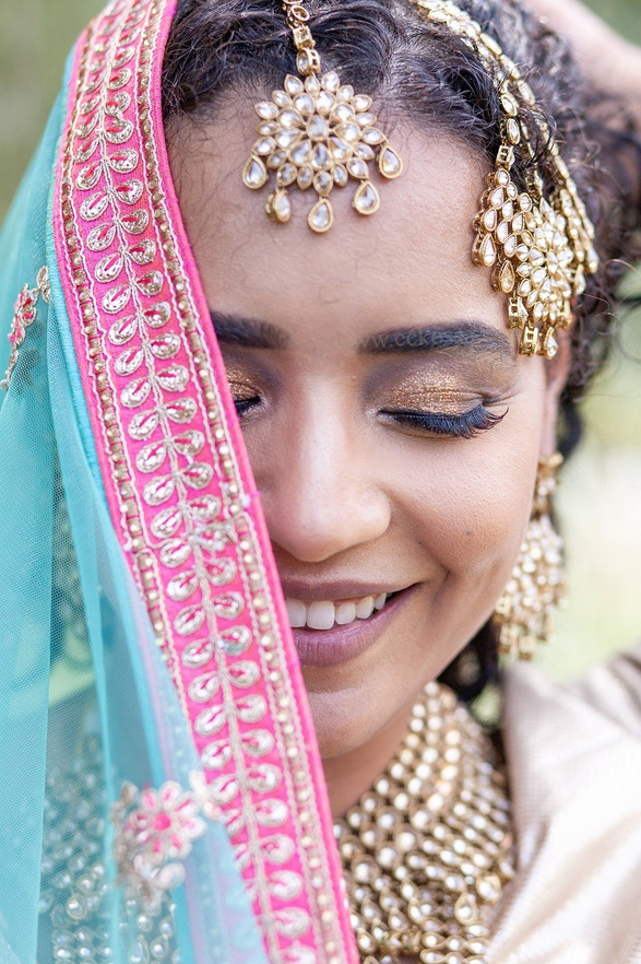 smiling south asian bride dupatta