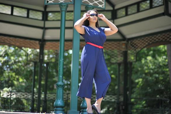 Fashion model blue jumpsuit sunglasses