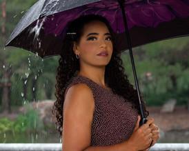 commercial model walking in rain