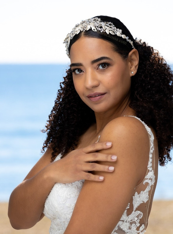 ethnically ambiguous bride at beach