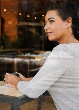 smiling model at cafe