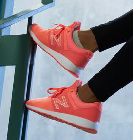 fitness model in orange sneakers