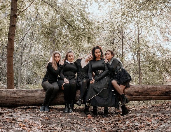 model dressed as witches in forest