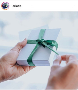 manicured hands opening gift