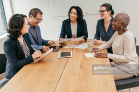 business woman smiling at head of table