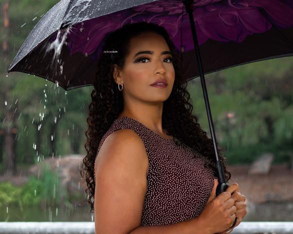 Commercial model posing in rain