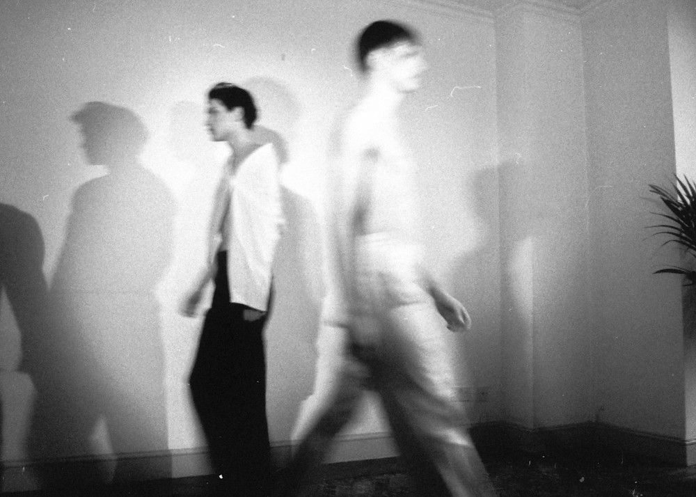 Aleksander wears deconstructed top by Lazkano and Acne Studios pants. Alex wears deconstructed trousers.