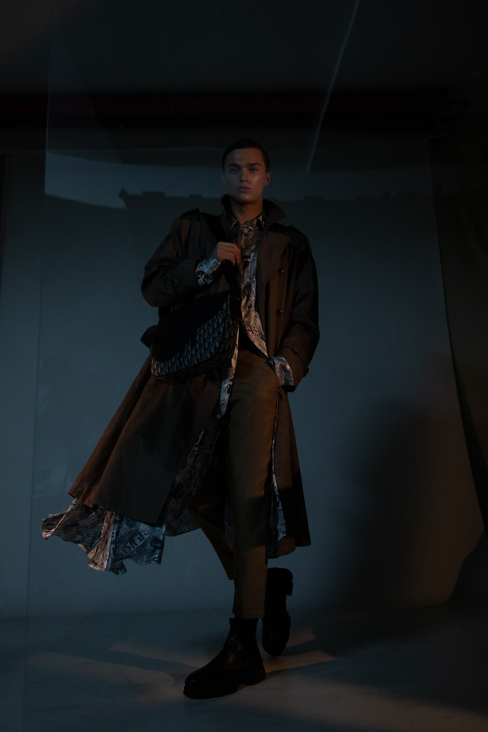 (left) coat BURBERRY shirt and bag DIOR MEN pants GIEVES & HAWKES boots STOCKHOLM STUDIOS (right) coat DIOR MEN