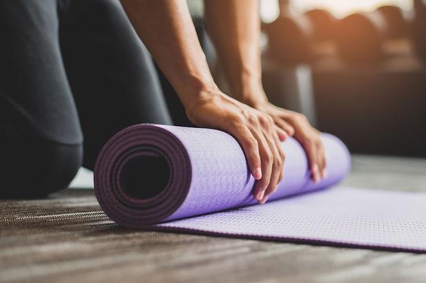 Young woman practicing yoga and meditati