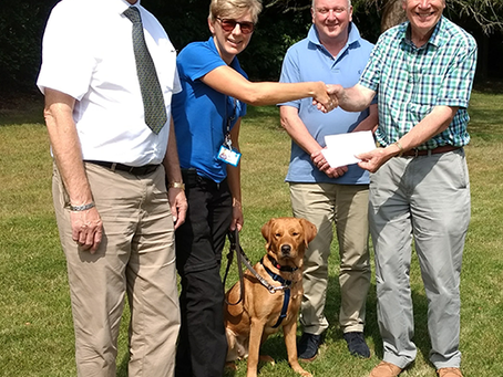 Athelstan hands over £1,000 to Guide Dogs for the Blind