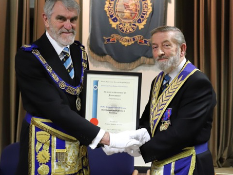 CHARITY AMBASSADOR RECEIVES 50 YEAR CERTIFICATE