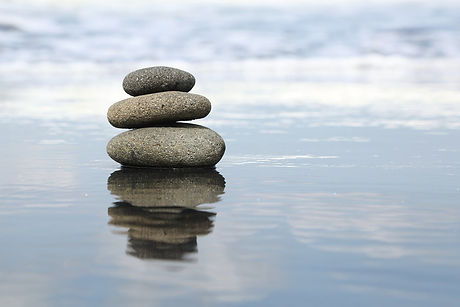 Balancing+Stones+in+Tranquil+Water.jpeg