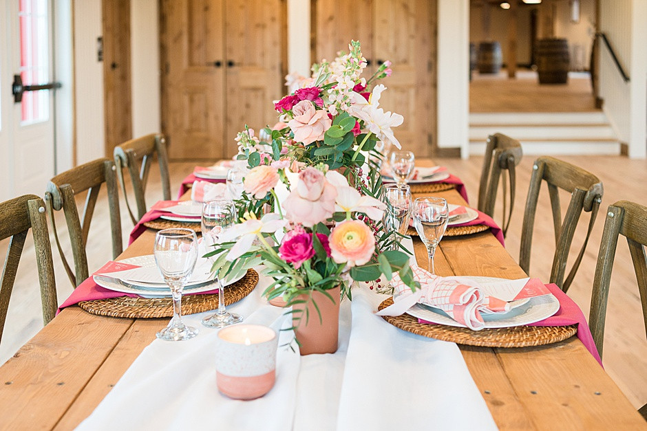wedding tablescape inspiration with pink flowers, bright colors, white and pink, with barnwood