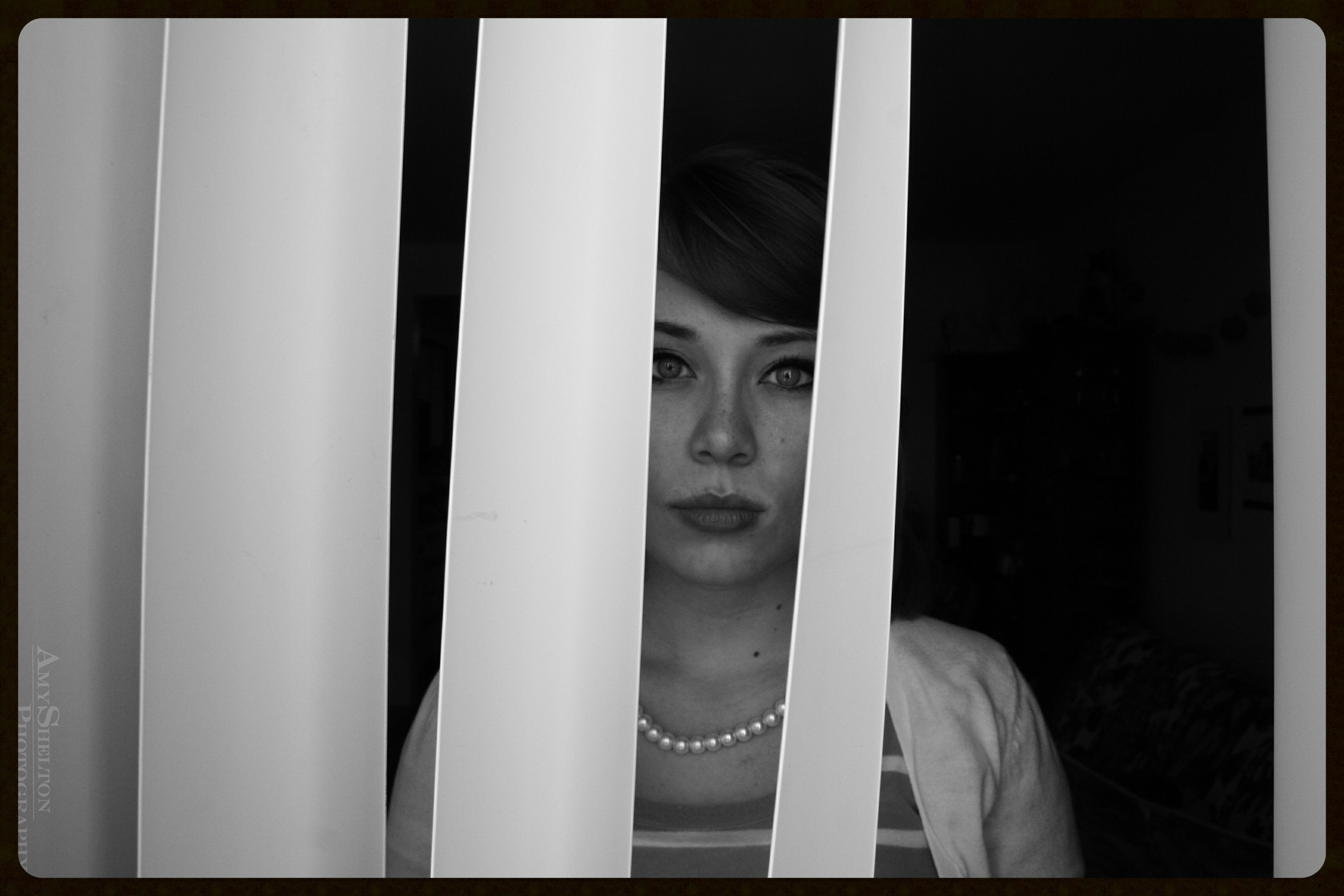 Jaclyn through Blinds