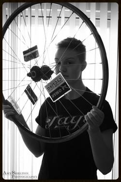 Patrick through his Bike Wheel