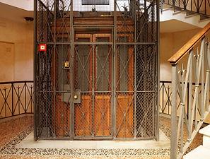 Old Wooden Elevator in a Metal Shaft.jpg