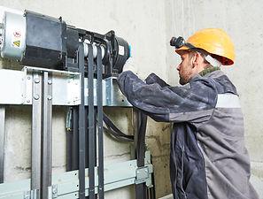 lift machinist repairing elevator in lif