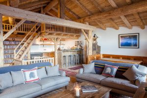 The living room at Chalet Rosière, available to book for last minute ski deals