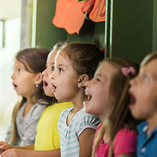 0_Group-of-elementary-students-singing-i