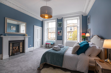 Blue bedroom with fireplace | interior photography
