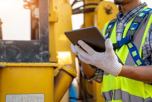 Engineer builder using tablet working ou