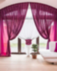 Big window with elegant drapes and curta