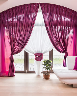 Big window with elegant drapes and curta