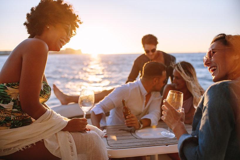 Group of men and women having a boat par