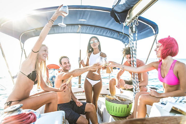 Multiethnic group of friends sailing on